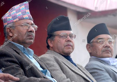 Senior Leaders of Nepals Communist Party of Nepal - Unified Marxist Leninist (cpn-uml) Madhav Nepal (l) Ghalnath Khanal (c) and Bamdev Gautam (r) Attend a Party Mass Meeting in Kathmandu Nepal 06 February 2009 the Cpn-uml the Third Largest Party in Nepal and a Coalition Partner of the Maoist-led Government Hold Their Warm -up Mass Meeting For Its General Convention On February 16-21