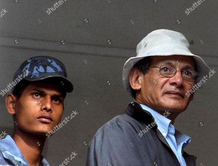Confessed Serial Killer Charles Sobhraj 63 (r) Guarded by Police Officers is Taken to the Police Custody After His Hearing at Supreme Court in Katmandu Nepal 27 August 2007 Four Years After He Was Sentenced to Life Imprisonment For the Murder of an American Backpacker Charles Sobhraj Once Wanted by the Police of Several Countries Finally Had His Break As the Supreme Court Today Began Hearing His Final Appeal For Freedom