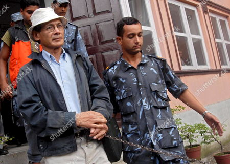 Confessed Serial Killer Charles Sobhraj 63 (l) Guarded by Police Officers is Taken to the Police Custody After His Hearing at Supreme Court in Katmandu Nepal 27 August 2007 Four Years After He Was Sentenced to Life Imprisonment For the Murder of an American Backpacker Charles Sobhraj Once Wanted by the Police of Several Countries Finally Had His Break As the Supreme Court Today Began Hearing His Final Appeal For Freedom