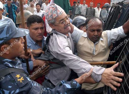 Nepalese Riot Police Arrest Bamdev Gautam (c) Central Leader of Nepal Communist Party- Uml During a Demonstration at New Road in Kathmandu On Sunday 04 September 2005 More Than Two Hundred Political Leaders and Cadres of the Seven Political Partys Alliance Were Arrested and Dozens Were Injured During the Demonstration Against King Gyanendras February Take Over