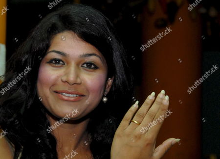 Fiancee of Confessed Killer Charles Sobhraj (not Pictured) Nihita Bishwas Shows Her Engagement Ring During a Press Conference in Kathmandu Nepal On 05 July 2008 Twenty-year-old Nihita Engaged with 64-year-old Confessed Killer Charles Sobhraj On 03 July at Bhadragol Jail in Kathmandu Nihita Who Met Sobhraj While He Was Looking For an Interpreter Continued Her Meetings with Him Until They Fell in Love the Serial Killer Sobhraj Was Arrested From a Kathmandu Casino in September 2003 and Was Sentenced to Life Imprisonment by a District Court in July 2004 On Charges of Murdering an American and a Canadian Tourist in Kathmandu in 1975
