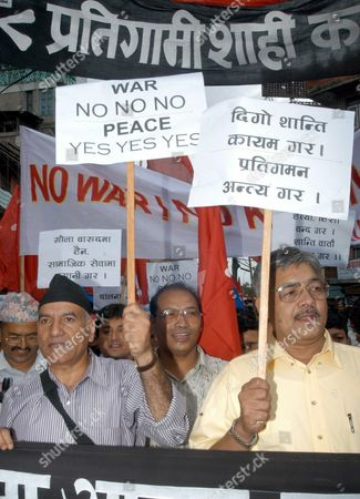 Amreet Bohara (l) and Bamdev Gautam (r) Central Leaders of Cpn- Uml (united Marxist and Leninist) Take Part in a Peace Rally in Katmandu Nepal On Thursday 31 July 2003 Over 2 000 Activist and Leaders Took Part in Rally to Appeal Both Government and Maoist to Come On Peace Table the Maoist Have Squeezed the Negotiating Space in the Last Two Weeks by Demanding the King's Involvement in the Dialogue Expulsion of American Military Advisors and Issuing a Five-day Ultimatum Till 31st July 2003 Epa Photo/epa/narendra Shrestha Nepal Kathmandu