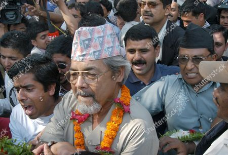 Central Leaders of Cpn- Uml (united Marxist and Leninist) Bamdev Gautam (l) and Former Deputy Prime Minister and Krishna Gopal Shrestha (r) Leave the District Court After Their Release in Kathmandu Nepal On Wednesday 18 May 2005