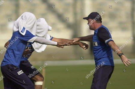India Cricket Team Coach Greg Chappell (r) Trains Blindfolded Players Mahendra Dhoni and Gambhir On Saturday 18 February 2006 During a Practice Session in Karachi the 5th and Final Match Between Pakistan and India Will Be Played Tomorrow Sunday in Karachi