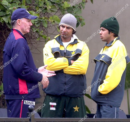 Pakistan A-team Batsmen Muhammad Waseem and Mansoor Amjad Listen to Indian Coach Greg Chappell (l) During the Last Day of a Three-day Practice Match On Monday 09 January 2006 in Lahores Bagah Jinnah Stadium