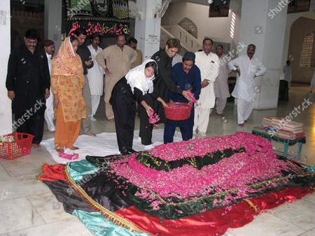 Asifa Zardari (c-l) the Younger Daughter of Slain Former Prime Minister Benazir Bhutto Showers Flowers at Her Mother's Grave in Gari Khuda Buksh Pakistan 25 August 2008 Former Prime Minister Benazir Bhutto Whose Party Won This Year's Crucial Parliamentary Elections and Whose Widower Asif Zardari Has Been Nominated by Her Party For the Slot of the President of Pakistan Was Assassinated During an Election Campaign in December 2007 in Rawalpindi Pakistan