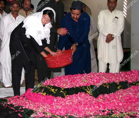 Asifa Zardari (l) the Younger Daughter of Slain Former Prime Minister Benazir Bhutto Showers Flowers at Her Mother's Grave in Gari Khuda Buksh Pakistan 25 August 2008 Former Prime Minister Benazir Bhutto Whose Party Won This Year's Crucial Parliamentary Elections and Whose Widower Asif Zardari Has Been Nominated by Her Party For the Slot of the President of Pakistan Was Assassinated During an Election Campaign in December 2007 in Rawalpindi Pakistan