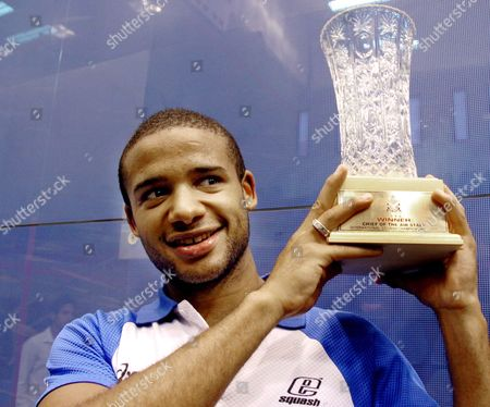 Winner of International Squash Championship Trophy 2005 British Player Adrian Grant Holds the Trophy in Islamabad On Saturday 27 August 2005 After Beating Pakistan's Mansoor Zaman 11-6 3-11 6-11 11-8 11-6