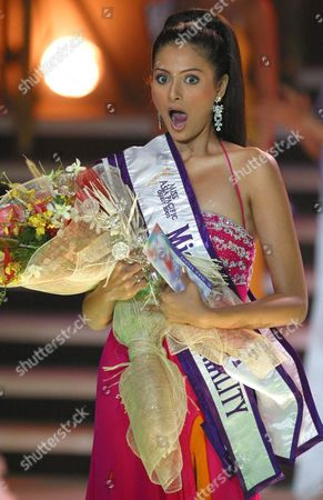 Stock Picture of Shonal Rawat of India (r) Reacts After Winning in Three Straight Categories During the Miss Asia Pacific 2003 Contest in Manila 26 October 2003 Shonal Rawat Won the Award For Miss Congeniality Best in Talent and Gandang Ricky Reyes and Eventually Was Named First Runner-up in the Pageant