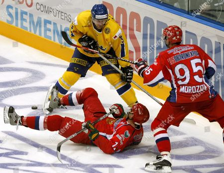 Alexei Morothov (r) and Danis Zaripov (l) of Russia Fight For the Puck with Peter Nordstrom (c) of Sweden During Ice Hockey Channel One Cur of the European Hockey Tour in Moscow 14 Desember 2006 After the Penalty Shoot-out Sweden Won 1-0