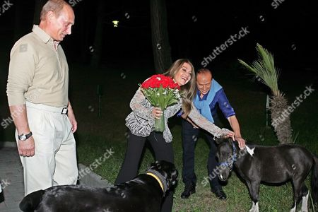 Italian Premier Silvio Berlusconi (r) and His Wife Veronica Lario (c) Stroke a Young Pony Prior to the Meeting with Russian President Vladimir Putin (l) in Putin's Residence Bocharov Ruchei in at the Black Sea Resort of Sochi Sunday 28 August 2005