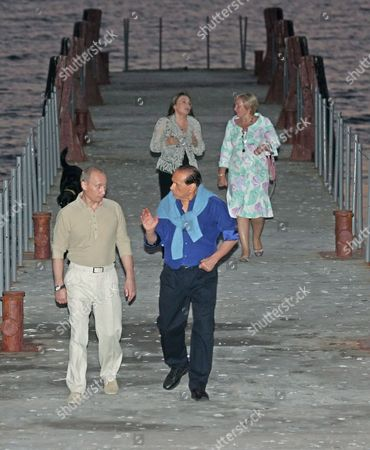 Italian Premier Silvio Berlusconi (r) and His Wife Veronica Lario Meet with Russian President Vladimir Putin and His Wife Lydmila Putina (rear Right) in Putin's Residence Bocharov Ruchei in the Black Sea Resort of Sochi Sunday 28 August 2005