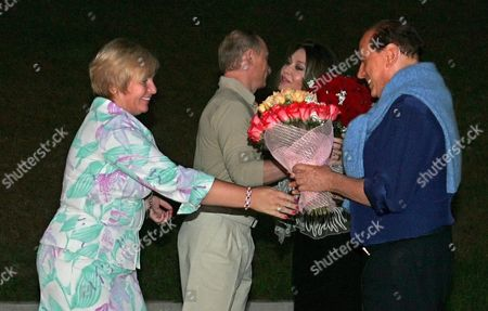 Italian Premier Silvio Berlusconi (r) and His Wife Veronica Lario Meet with Russian President Vladimir Putin and His Wife Lydmila Putina (l) in Putin's Residence Bocharov Ruchei in the Black Sea Resort of Sochi Sunday 28 August 2005