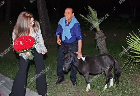 Italian Premier Silvio Berlusconi (r) and His Wife Veronica Lario (c) Stroke a Young Pony Prior to the Meeting with Russian President Vladimir Putin in Putin's Residence Bocharov Ruchei in at the Black Sea Resort of Sochi Sunday 28 August 2005