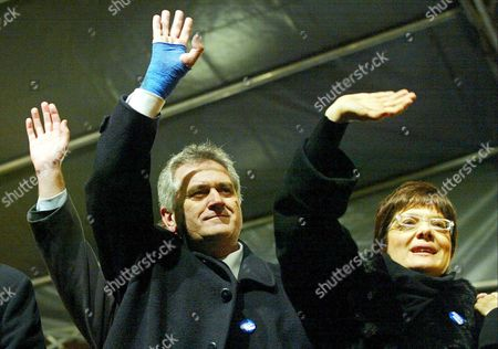 Tomislav Nikolic (c) and Maja Gojkovic (r) of the Ultranationalist Serbian Radical Party Greet Their Supporters at the Party's Final Pre-election Rally Held in Novi Sad 23 December 2003 Parliamentary Elections in Serbia Are Scheduled For 28 December 2003