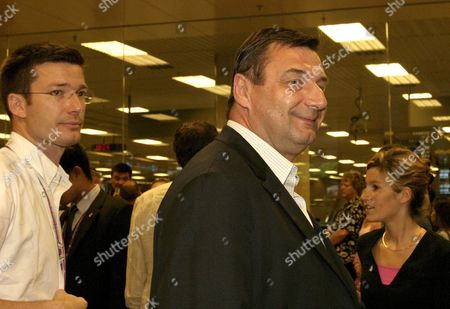 French Minister of Sports Jean- Francois Lamour (c) Arrives at Singapore Changi Airport Sunday 03 July 2005 to Support the Paris 2012 Bid in the 117th International Olympic Committee Session to Be Held in Singapore On 6 July 2005 Paris Will Be Competing with London Madrid and Moscow For the Bid to Host the 2012 Olympic Games