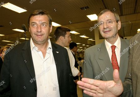 French Minister of Sports Jean-francois Lamour (l) Arrives and is Received by French Embassador to Singapore His Excellency Jean-paul Reau at Singapore Changi Airport On Sunday 03 July 2005 to Support the Paris 2012 Bid in the 117th International Olympic Committee Session to Be Held in Singapore On 6 July 2005 Paris Will Be Competing with London Madrid and Moscow For the Bid to Host the 2012 Olympic Games