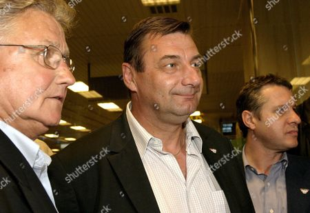 French Minister of Sports Jean-francois Lamour (centre) Arrives at Singapore Changi Airport with Former Olympians 1500 Metre Event Gold Medalist Michel Jazy (l) and Judo Gold Medalist Tierry Rey (r) On Sunday 03 July 2005 to Support the Paris 2012 Bid in the 117th International Olympic Committee Session to Be Held in Singapore On 6 July 2005 Paris Will Be Competing with London Madrid and Moscow For the Bid to Host the 2012 Olympic Games