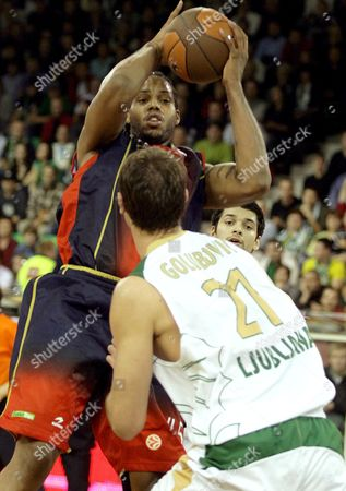 Will Mcdonald of Tau Ceramica (l) Fights For the Ball with Vladimir Golubovic of Union Olimpija (r) During Their Second Round Champions League Group C Basketball Match in Ljubljana Slovenia On 30 October 2008