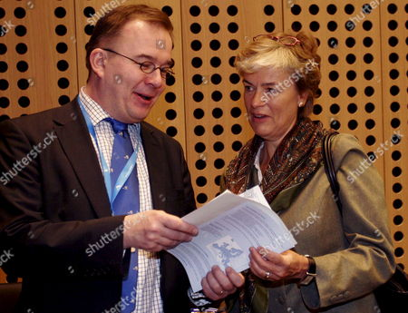 Ernst Hirsch Ballin (l) Minister of Justice of the Netherlands Talks with Finland's Minister of Migration and European Affairs Astrid Thors (r) Before the Start of an Informal Meeting of European Union (eu) Ministers of Justice and Home Affairs in Brdo Slovenia On 25 January 2008 Slovenia Currently Holds the Eu Presidency