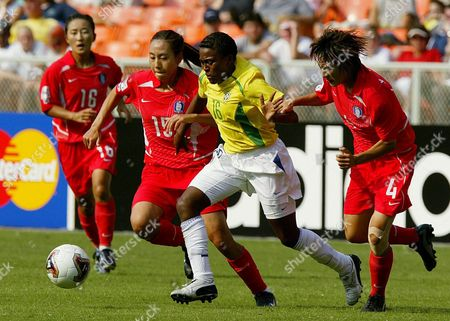 Brazil's Maicon (16) Dribbles Past Korea's Yu Jin Kim (4) and Kyul Sil Kim During the First Half of the Korea Vs Brazil Women's World Cup Match at Rfk Stadium in Washington Dc On Sunday 21 September 2003 at the Half Brazil Leads 1-0 Epa Photo/epa/shawn Thew// United States Washington