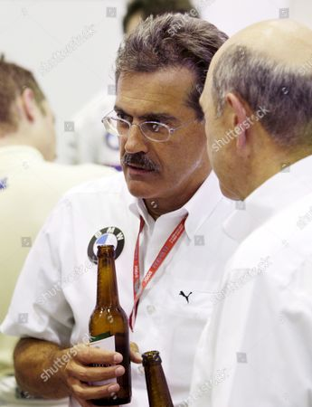 German Dr Mario Theissen (l) Bmw Motorsport Director of Bmw Sauber is Seen in the Team's Garage Celebrating the Third Place of Robert Kubica with a Bottle of Beer After the Grand Prix of Europe at Valencia Street Circuit in Valencia Spain On 24 August 2008