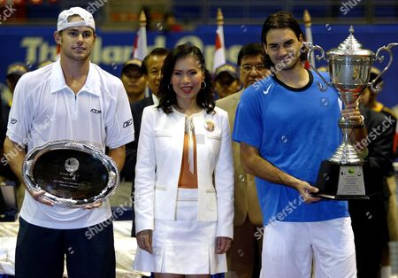 Roger Federer From Switzerland (r) Holds the King's Cup Thailand Open Trophy After Beating Opponent and World Number Two Andy Roddick Usa (l) in the Final of the Thailand Open in Impact Arena Stadium Bangkok Thailand Sunday 03 October 2004 Thai Princess Ubol Ratana the Oldest Child of King Bhumibol Adulyadej and Queen Sirikit of Thailand Who Presented the Trophies is in the Centre