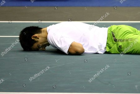 Novak Djokovic of Serbia Lies Down On the Court As He Play with Simon Stadler of Germany During Their Second Round Match of the Atp Thailand Open Tennis Tournament 2008 at the Impact Arena in Bangkok Thailand 25 September 2008 Djokovic Won Stadler 6-1 6-3