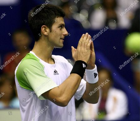 Stock Picture of Novak Djokovic of Serbia Greets the Crowd in Thai Tradition After Defeating Simon Stadler of Germany During Their Second Round Match of the Atp Thailand Open Tennis Tournament 2008 at the Impact Arena in Bangkok Thailand 25 September 2008 Djokovic Won Stadler 6-1 6-3