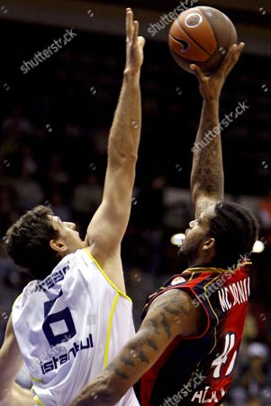Tau Ceramica's Will Mcdonald (r) Tries to Score Past Fenerbahce Ulker's Mirsad Turkcan During Their Euroleague Group C Match at Abdi Ipekci Arena in Istanbul Turkey On 04 December 2008