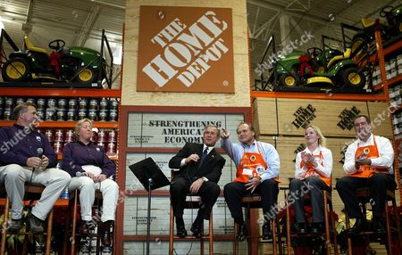 Us President George W Bush with Gary Mangum (l) and Alison Anderson (2nd L) of Bell Nursuries John Ferriaoulo (r) and Jessica Adamson (2nd R) of the Home Depot Listens to Ceo of the Home Depot Bob Nardelli (3rd R) As He Points out an Employee Serving in the Us Military During His Visit and Discussion at the Home Depot in Halethorpe Md Friday 05 December 2003 Bush Used the Home Depot As an Example of the Surging Economy