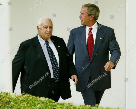 Us President George W Bush (r) with Israeli Prime Minister Ariel Sharon Walks Down Through the Colonade As Reporters Shout Questions at the Two Leaders After They Made Brief Statements in the Rose Garden at the White House in Washington Dc 29 July 2003 Earlier the President and Prime Minister Met in the Oval Office to Discuss the Mideast Peace Process and Concessions Israel is Prepared to Make Epa Photo/epa/shawn Thew United States Washington
