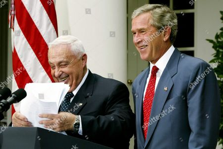 Us President George W Bush (r) Shares a Laugh with Israeli Prime Minister Ariel Sharon As He Tries to Find His Place During the Brief Statements by the Two Leaders in the Rose Garden at the White House in Washington Dc Tuesday 29 July 2003 Epa Photo/epa/shawn Thew United States Washington
