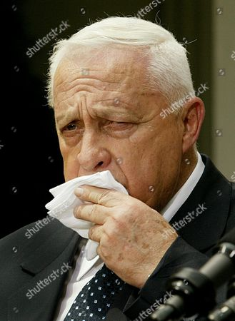 Israeli Prime Minister Ariel Sharon Wipes His Face During a Briefing with Us President George W Bush in the Rose Garden at the White House in Washington Dc 29 July 2003 Earlier the President and Prime Minister Met in the Oval Office to Discuss the Mideast Peace Process and Concessions Israel is Prepared to Make Epa Photo/epa/shawn Thew United States Washington