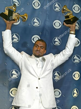 Kanye West Holds His Three Awards After the 47th Annual Grammy Awards at the Staples Center in Los Angeles Sunday 13 February 2005
