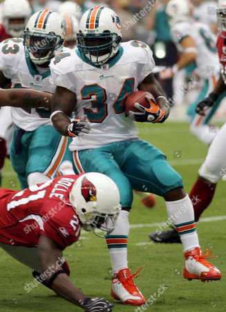 Miami Dolphins Runningback Rickie Williams is Turned Around by Arizona Cardinals Antrel Rolle During the First Quarter of Their Nfl Game in Glendale Arizona Usa 14 September 2008