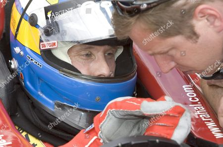 Kenny Brack of Sweden (l) Receives Instructions From a Pit Crew Member During Brack's First Practice Session in 2005 at the Indianapolis Motor Speedway in Indianapolis Indiana Wednesday 18 May 2005 Brack Who Was Seriously Injured in a Horrific Crash in the Indy Racing League in 2003 Will Race in the 89th Indianapolis 500 This Month Replacing Defending Champion Us Buddy Rice