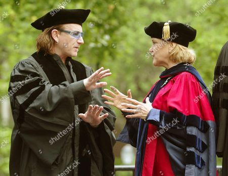 Bono (l) Lead Singer of the Irish Rock Band U2 and Judith Rodin (r) President of the University of Pennylvania Talk Briefly Prior to the Start of the Commencement Ceremony at the University of Pennsylvania Monday 17 May 2004 in Philadelphia Pennsylvania Bono Who Gave the Commencement Address Later Received the Honorary Degree of Doctor of Law For His Work As an Activist Fighting Aids and Extreme Poverty in Africa