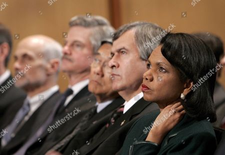 Members of U S President George W Bush's Cabinet (r-l) Secretary of State Condoleezza Rice Secretary of Agriculture Mike Johanns Secretary of Transportation Norman Mineta Secretary of Veterans Affairs Jim Nicholson and Secretary of Homeland Security Michael Chertoff Listen As the President Announces a New Strategy On How to Prepare For a Potential Flu Pandemic Caused by the Asian Bird Flu Or Some Other Super-strain of Influenza at the National Institutes of Health in Bethesda Maryland On Tuesday 01 November 2005 the Preparations Are Expected to Cost at Least $6 5 Billion (5 4 Billion Euro)