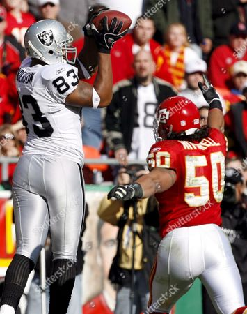 Stock Photo of Oakland Raiders' Player Courtney Anderson (l) Catches the Ball For a Touchdown in Front of Kansas City Chiefs' Player Kawika Mitchell (r) in the First Half of the Game at Arrowhead Stadium in Kansas City Missouri Sunday 19 November 2006