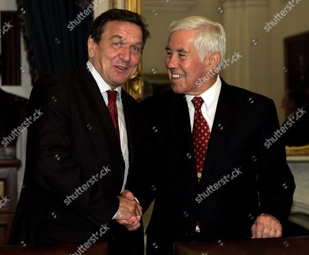 German Chancellor Gerhard Schroder (l) Shakes Hands with Chairman of the Senate Foreign Relations Committee Sen Richard Lugar (r-indiana) On Capitol Hill in Washington Dc On Monday 27 June 2005