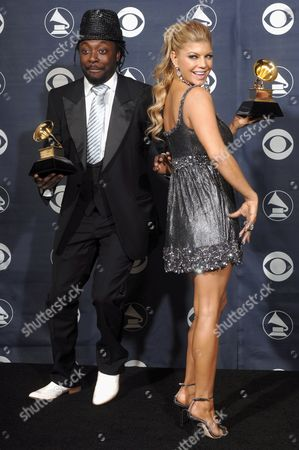 Will i Am and Fergie From the Black Eyed Peas Hold the Grammy the Group Won For 'My Humps' For Best Pop Performance by a Duo Or Group with Vocals at the 49th Annual Grammy Awards in Los Angeles On Sunday 11 February 2007