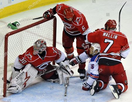 The New York Rangers Sean Avery (c) Gets Tangled Up with Carolina Hurricanes Niclas Wallin (r) Tim Gleason (top-c) and Goaltender Cam Ward (l) During the Second Period of Their Nhl Ice Hockey Game in Raleigh North Carolina Usa 02 April 2009 Carolina Won 4-2