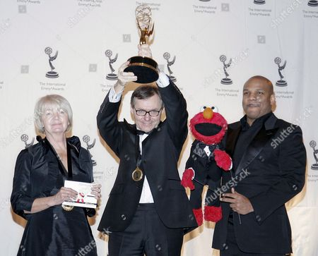 Polish Director Andrzej Maleska Holds the International Emmy For Children and Young People 'The Magic Tree' Along with Editor Hanna Probulska-dzisiow and Elmo Puppeteer Kevin Clash at the 35th Annual International Emmy Awards Gala in New York Usa 19 November 2007 the International Academy of Television Arts & Sciences is the Largest Organization of Global Broadcasters with Members From Nearly 70 Countries and Over 400 Companies Sixty Percent of the Board of Directors Come From Countries Based Outside of the U S and Represents the World's Largest Production Distribution and Broadcast Companies
