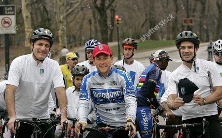 Olympian and Six -time Tour De France Champion Lance Armstrong (c) Takes a Short Bike Ride with Deputy Mayor and Founder of New York's 2012 Bid Dan Doctoroff (l) and Parks Commissioner Adrian Benepe to Show His Support For New York City's Bid For the 2012 Olympic Games in New York's Central Park Thursday 07 April 2005