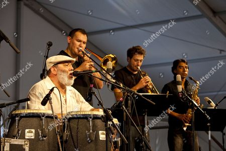 Latin Jazz Band Leader Conga Player and Salsa Singer Poncho Sanchez Performing On the Wwoz Jazz Tent Stage at the New Orleans Jazz and Heritage Festival at the New Orleans Fair Grounds Race Course in New Orleans Louisiana Usa 01 May 2009 New Orleans Jazz and Heritage Festival Or Jazzfest Celebrates It's 40th Anniversary This Year with 12 Different Stages in an Annual 7-day Cultural Event That Encompasses Every Style Associated with the City of New Orleans Including Jazz Gospel Cajun Zydeco Blues Rhythm and Blues Rock Funk African Latin Caribbean Folk and Much More in Addition to Food Booths with Local Cuisine Exhibits Arts and Crafts