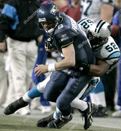Seattle Seahawks' Quarterback Matt Hasselbeck (l) Scrambles For Yards While Getting Tackled by Carolina Panthers' Linebacker Chris Draft During the Nfc Championship Playoffs at Qwest Field in Seattle Washington Sunday 22 January 2006 the Seahawks Defeated the Panthers 34-14