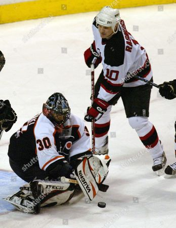 The Philadelphia Flyers Goalie Antero Niittymaki Makes a Save On a Shot by the New Jersey Devils Erik Rasmussen (r) in the 3rd Period of Play at the Center in Philadelphia Pennsylvania Tuesday 10 Febuary 2004 Niittymaki Has Won 3 of the 3 Games He Has Played For the Team the Flyers Won 4-1