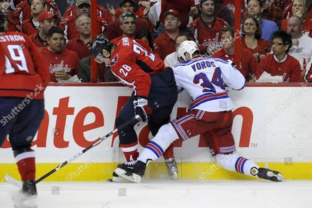 New York Rangers Left Wing Aaron Voros (r) Hits Washington Capitals Left Wing Alexander Semin (l) During the Second Period of Game Seven of the Eastern Conference Quarterfinals Between the New York Rangers and the Washington Capitals at the Verizon Center in Washington Dc Usa On 28 April 2009