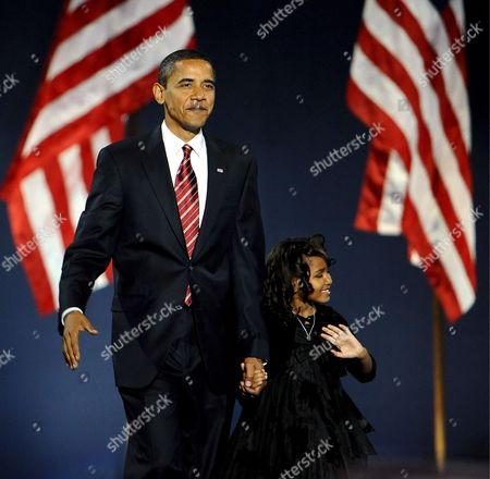 Democratic Presidential Candidate Barack Obama Waves As He Walks Onstage with His Daughter Natasha to Address a Crowd at Grant Park in Chicago Illinois Usa to Celebrate His Victory On Election Day 04 November 2008 Obama Defeated Republican Presidential Candidate John Mccain to Become the 44th President of the United States and the First Black President in Us History